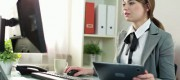 stock-footage-businesswoman-working-on-tablet-computer-in-the-office